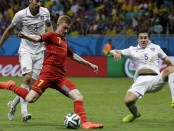 Belgium's Kevin De Bruyne scores the opening goal against the United States during extra time.